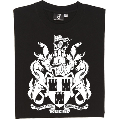 Newcastle Coat of Arms T-Shirt. The Coat of Arms for the city of Newcastle (and he first badge to be worn on Newcastle United shirts). In Latin at the bottom is the motto of the city: Fortiter defendit triumphans which translated into English means triumphing by brave defence